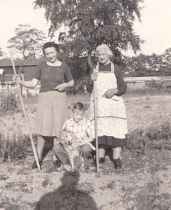 My grandmother working on the family farm with her mother-in-law while my dad enjoys his dog.
